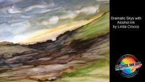 Create dramatic sky with alcohol ink